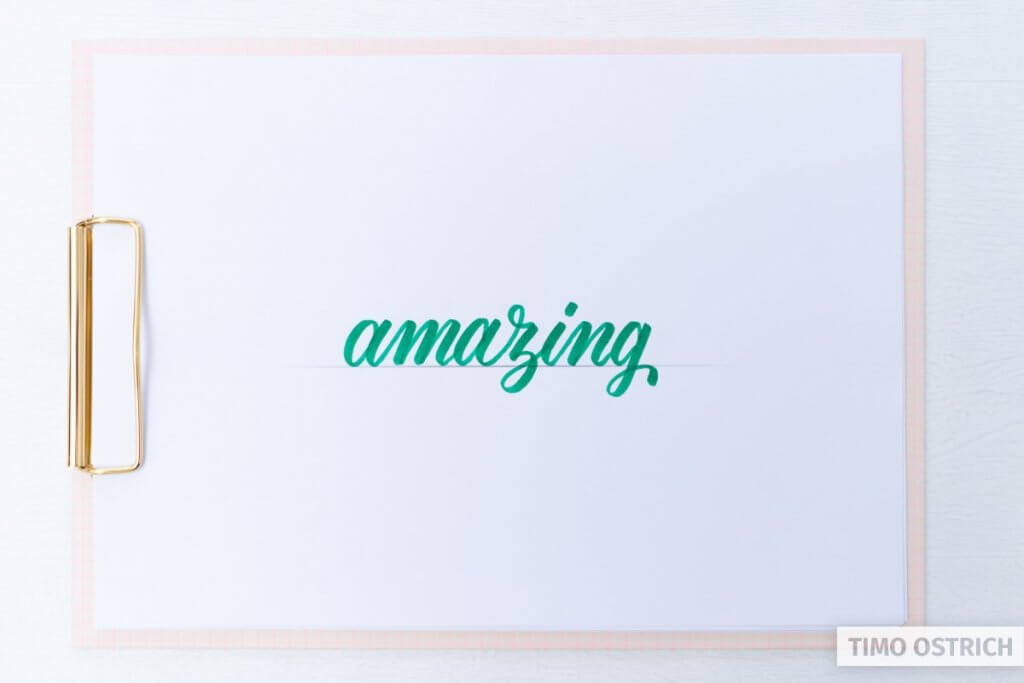 Brush lettering the word amazing