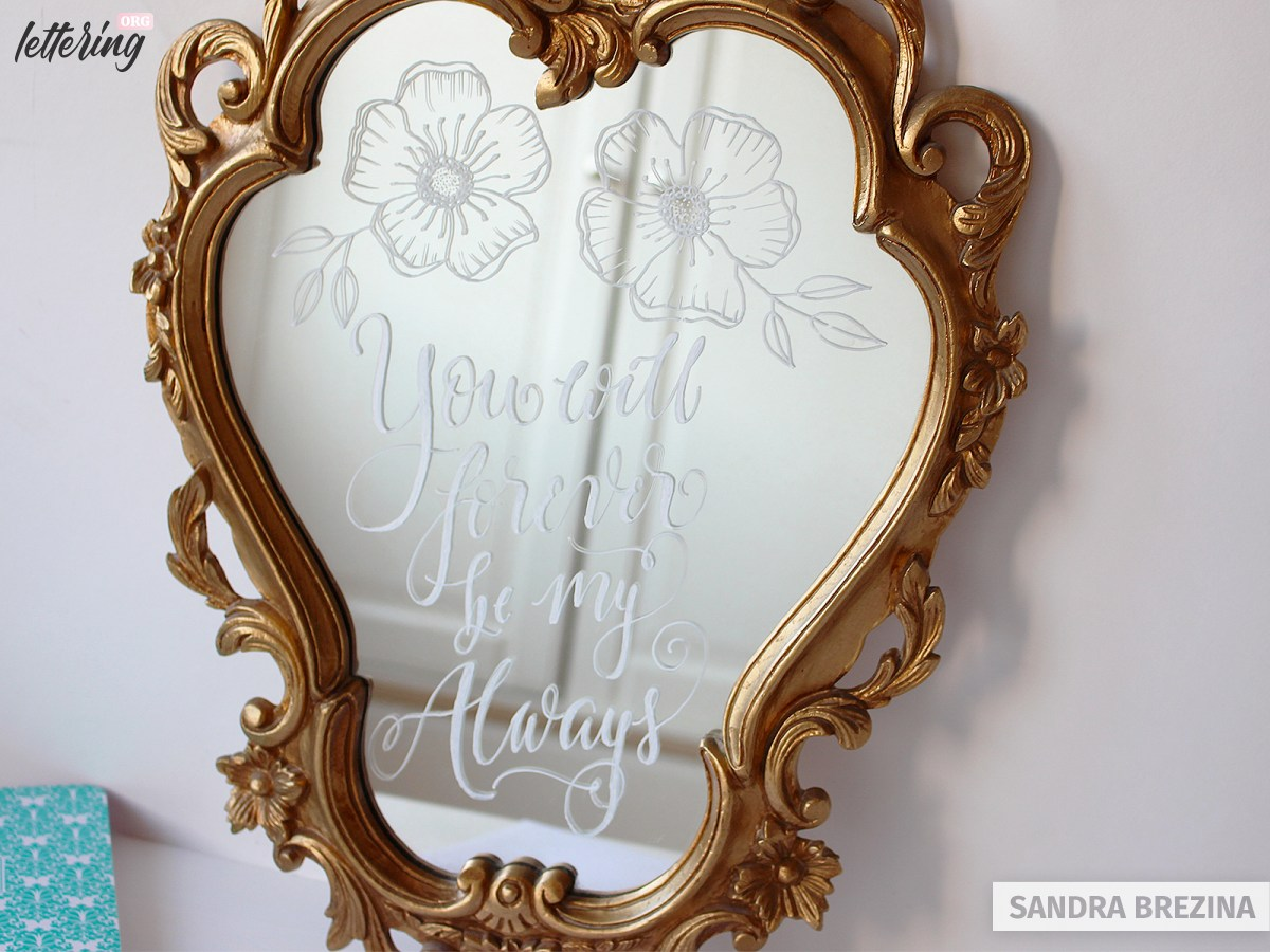 Hand lettered artwork on a mirror